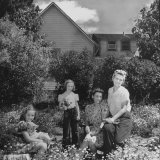 Patricia Colleen Altree Sitting in the Garden with Her Family Photographic Print by J. R. Eyerman