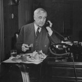 Jesse H. Jones Eating Lunch in His Office and Talking on the Telephone Photographic Print by Myron Davis