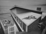 Guests Playing Cards and Sunbathing at Cliffside Home of W. M. MacConnell Photographic Print by Peter Stackpole