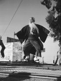 Elderly Japanese Movie Extra Jumping on Trampoline Premium Photographic Print by Ralph Crane