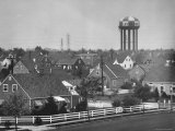 Levittown Water Tank Looming over Middle Class Homes in New Housing Development Premium Photographic Print by Joe Scherschel