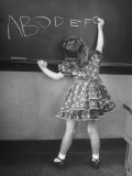 Little Girl Learning Her Abc's Photographic Print by Nina Leen