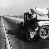 Car Laden with Baggage on Desolate Track of Highway in Desert in Southern California Photographic Print by Dorothea Lange