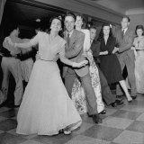 Men and Women Doing the Conga at the Scott Hotel Photographic Print by Myron Davis