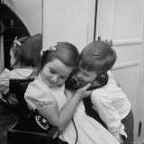 Brother and Sister Sharing the Telephone to Talk to Santa Claus Photographic Print by Martha Holmes