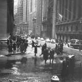 Pedestrians Crossing Slushy Intersection at Wall Street Photographic Print by Walker Evans