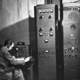 Agent of the FBI Listening to a Message Being Transferred Via Radio Photographic Print by Thomas D. Mcavoy