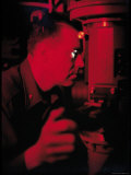 Comm. James Calvert Looking Through Periscope in Control Center Aboard Nuclear Submarine USS Skate Premium Photographic Print by Hank Walker
