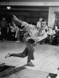 Bob Jones Bowling with a Cigar Hanging Out of His Mouth Photographic Print by Ralph Morse