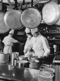 Chefs Cooking in a Restaurant Kitchen at Radio City Photographic Print by Bernard Hoffman