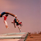People Bouncing on Trampolines at Trampoline Center Photographic Print by J. R. Eyerman