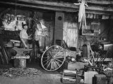 Blacksmith Working in His Shop Premium Photographic Print by John Phillips