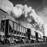 View of a Railcar Loaded with Iron Ore Moving Along the Tracks Photographic Print by Charles E. Steinheimer