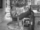 Man Taking Off Work and Sitting on Porch Premium Photographic Print by John Florea