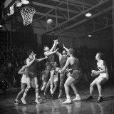 Champion Amateur Phillips 66ers Blocking Out Members of the Opposing Team Photographic Print by Cornell Capa
