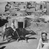 Man Riding a Water Buffalo Through Village North of Luxor Photographic Print by Eliot Elisofon
