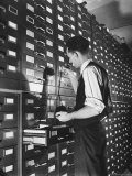 Man Looking at Film Records Containing Social Security Numbers at the Social Security Board Premium Photographic Print by Thomas D. Mcavoy