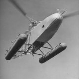 Igor Sikorsky Landing Helicopter Photographic Print by Dmitri Kessel