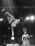 Circus Performer Balancer Unus Standing on His Index Finger on Globe Feet in Air Back of Head Premium Photographic Print by Ralph Morse