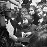 Children Singing Around the Piano at Orphanage Photographic Print by Tony Linck