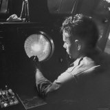 Man Looking at Radar Scope to Gather Weather Information Photographic Print by George Skadding