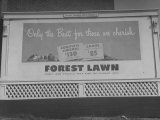 Close Up of Sign Advertising Forest Lawn Cemetery Photographic Print by George Strock
