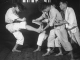 Japanese Karate Student Breaking Boards with Kick Premium Photographic Print by John Florea