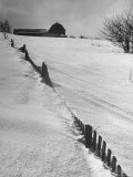 Four Ft. of Snow Almost Covering Up Snow Fence in Front of Barn on the Hill on Upstate Farm Premium Photographic Print by Andreas Feininger