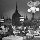 Patrons Drinking and Dining at an Outside Cafe with Cathedral in Background Photographic Print by Dmitri Kessel