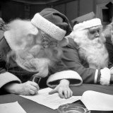 Santa Clauses Take a Written Examination For Diploma After Listening to Lectures Photographic Print by Martha Holmes