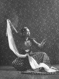 Balinese Dancer Devi Dja Performing Premium Photographic Print by Marie Hansen