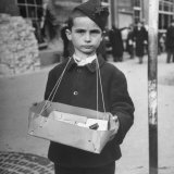 Little Boy Selling a Box of Items That Has Been Hung Around His Neck Photographic Print by John Phillips