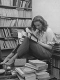 French Actress Barbara Laage, Alone in Her Apartment Reading Premium Photographic Print by Nina Leen