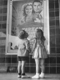 Children Looking at Posters Outside Movie Theater Premium Photographic Print by Charles E. Steinheimer
