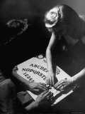 People Playing with a Ouija Board Photographic Print by Wallace Kirkland
