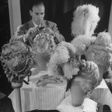 Chief Hair Stylist Sydney Guilaroff, Styling Wigs at the MGM Studio Photographic Print by Walter Sanders