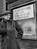 Man Standing Beside Anti Labor Government Sign on Shop Premium Photographic Print by Nat Farbman