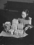 Chinese Girl Holding Currency Premium Photographic Print by Jack Wilkes
