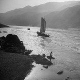 Chinese Junk Boat Sailing Past a Spear Fisherman on the Shore of the Yangtze River Photographic Print by Dmitri Kessel