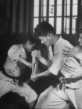 Japanese Karate Student Breaking Boards with Punch Photographic Print by John Florea