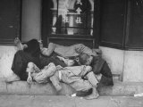 Coolies Taking an Afternoon Nap on Steps of a Hotel Premium Photographic Print by John Florea