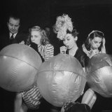 Three Women Having a Contest to See Who Can Blow the Balloons Up the Fastest Photographic Print by Myron Davis