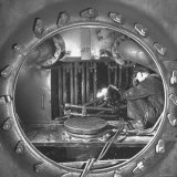 Welder with an Acetylene Torch Cutting Through Some of the Old Tubes in a Modern Locomotive Photographic Print by Thomas D. Mcavoy