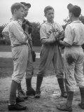 Boys Having a Discussion Before Playing Baseball Premium fotografisk trykk av Nina Leen