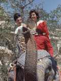 First Lady Jackie Kennedy and Sister Lee Radziwill Riding an Elephant While Visiting India Premium Photographic Print by Art Rickerby