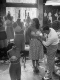 Designer Jack Glick Fitting a Strapless Bra on Model Lámina fotográfica de primera calidad por Nina Leen