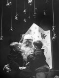 Department Store Santa Clause with Talking with Two Boys Sitting on His Lap Premium Photographic Print by Jerry Cooke