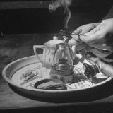 Customer Cooking Up the Opium to Prepare It For Smoking Photographic Print by George Lacks