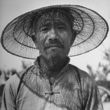 Farmer Wearing a Cool, Airy Straw Hat Photographic Print by Mark Kauffman