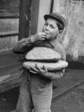 Little Boy Holding Loaves of Bread Photographic Print by Walter Sanders